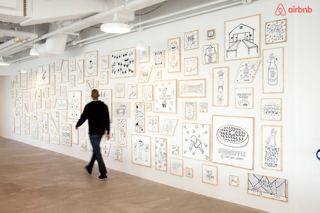 Decorative wall with illustrations of shared employee experiences