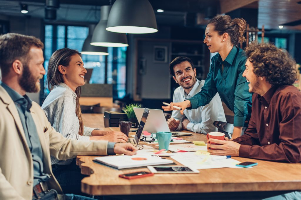 Smiling group of people collaborating in an office