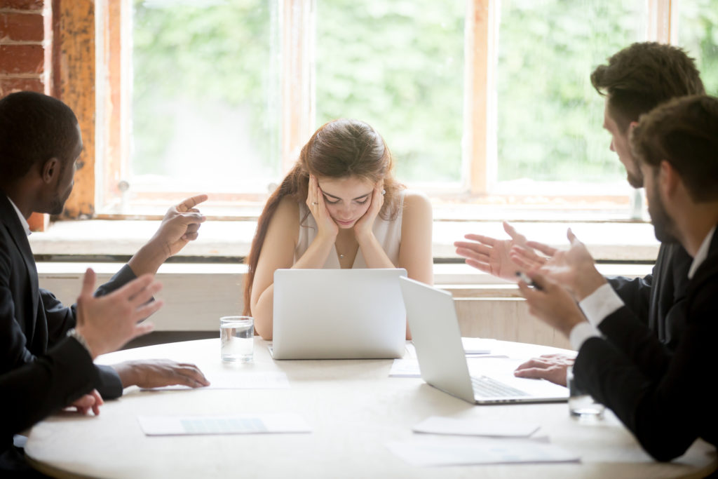 Employee feeling overwhelmed in a meeting